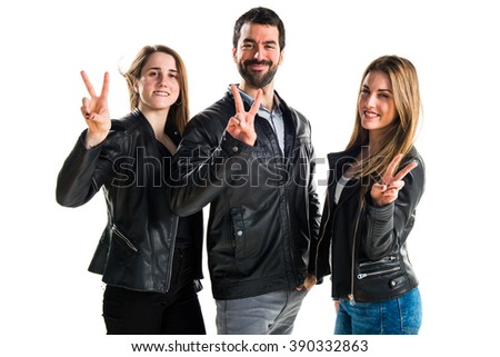People doing victory gesture