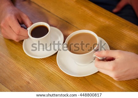 People drinking coffee in the cafe