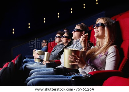 People in 3D glasses in cinema