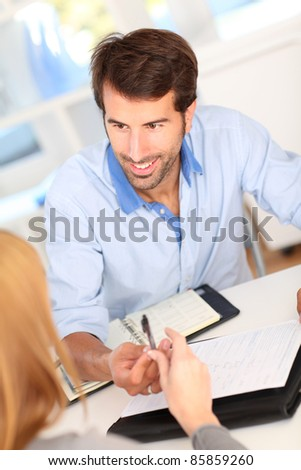 People in office signing contract