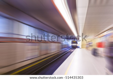 people in subway station, blurred urban background