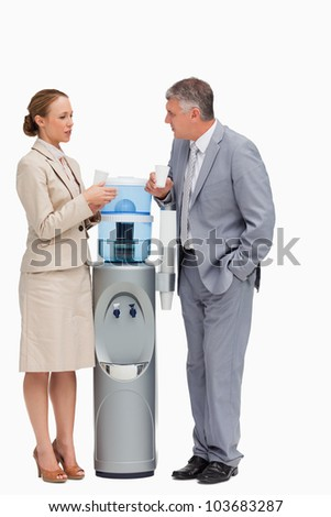 People in suit talking next to the water dispenser against white background