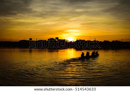 people paddle in the lake at sunset time, silhouette, teamwork concept