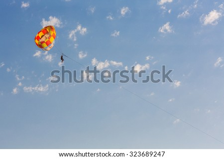 People parasailing over the sea