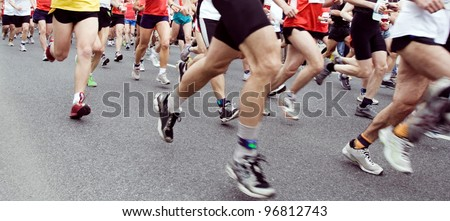 People running marathon on city street, sport and fitness on the urban road. Runners on the race, only legs and shoes