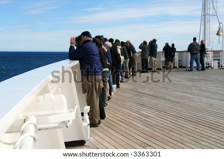 People Standing at Cruise Ship Railing