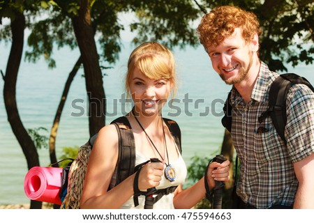 People tourists hiking backpacking outdoor. Backpackers couple on summer vacation trip journey.
