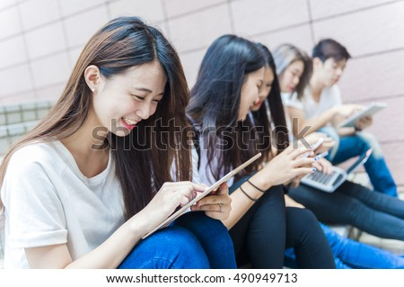 people using smart phones with touchscreen technology