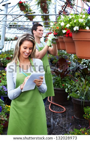 People working in nursery. Gardening background.