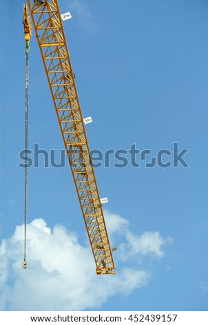 PERAK, MALAYSIA -FEBRUARY 02, 2016: Tower Crane used to lifting heavy load at construction site in Perak, Malaysia