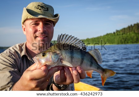 Perch fishing in summer lake