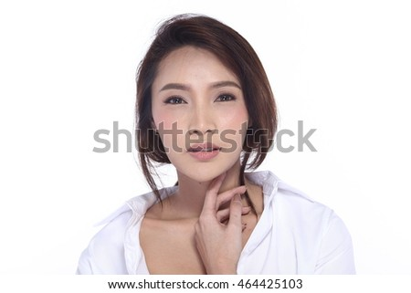Perfect Healthy Female Model with Natural Beauty Clean Look Fashion Make Up style in White Shirt, long hair, White Background in Studio Lighting, the concept of health, smile Face