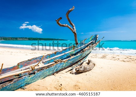 Perfect tropical island paradise beach with old wooden fishing boat on the sandy beach, Maldives