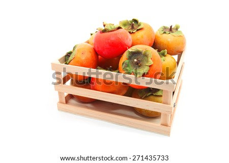 Persimmons in the wooden box on white background