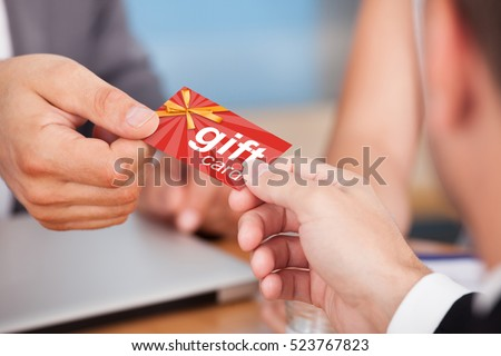 Person Giving Gift Card