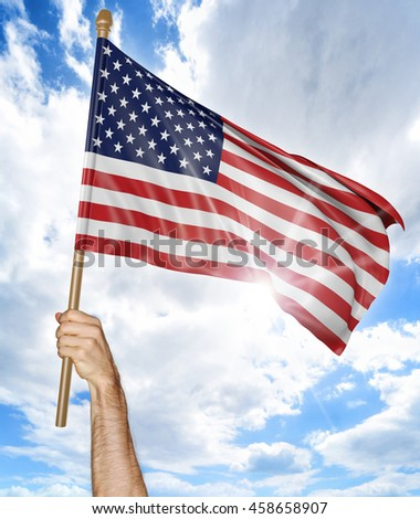 Person's hand holding the American national flag and waving it in the sky, 3D rendering