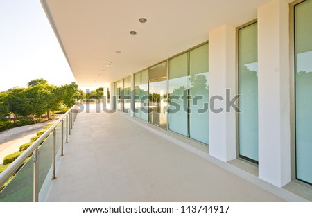 Perspective of the modern glass and steel balcony, deck, promenade railing. Exterior, interior design.