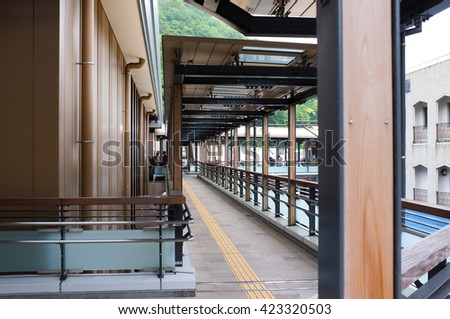Perspective view along the walkway in between the Hakone rail station and the nearby buildings.