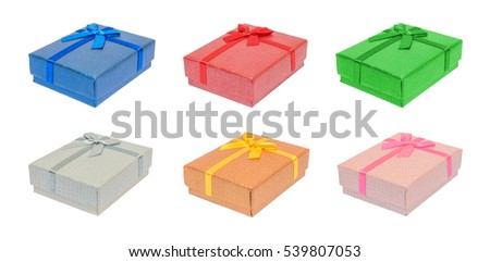 Perspective view of various shiny colorful blue, red, green, silver, gold, pink rectangle christmas gift or present boxes, isolation on white background with clipping path