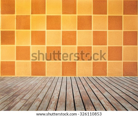 Perspective wooden floor with chequered tiled wall