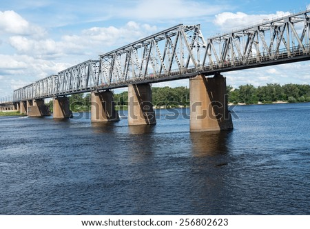 Petrivskiy railroad bridge in Kyiv (Ukraine) across the Dnieper. View from the right bank of the river.