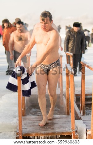 PETROPAVLOVSK, KAZAKHSTAN- JANUARY 19, 2017: The Baptism of Russia celebration. Orthodox church Holy Epiphany Day. People bathe in the hole. Weather -22, winter.