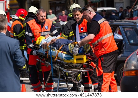 PEZINOK, SLOVAKIA - MAY 8, 2016: Volunteer fire fighters participate in a vehicle extrication demonstration and training in Pezinok, Slovakia