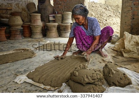 Phan Rang, VIETNAM, November, 2: woman of village pottery  Bau Truc  kneading soil before clay ceramic on November, 2 ,2014 in Bau Truc, Vietnam. Using traditional technique