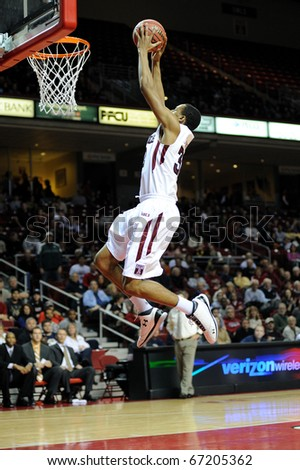 PHILADELPHIA - DECEMBER 12: Temple University forward Rahir Jefferson appears to fly as he glides in for a slam dunk in a game December 12, 2010 in Philadelphia