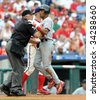 PHILADELPHIA - JULY 26: St. Louis Cardinals shortstop Julio Lugo collides with umpire Brian O'Nora after scoring a run during the July 26, 2009 game in Philadelphia. - stock photo