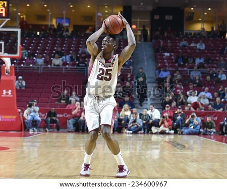 PHILADELPHIA - NOVEMBER 25: Temple Owls guard Quenton DeCosey (25) readies to shoot a three pointer during the Big 5 basketball game November 25, 2014 in Philadelphia.