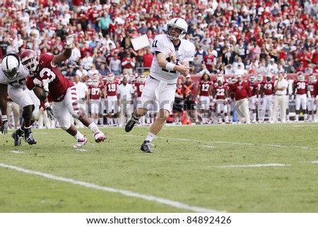 PHILADELPHIA, PA. - SEPTEMBER 17: Penn State Quarterback back Matthew McGloin looks to pass down field in a game against Temple on September 17, 2011 at Lincoln Financial Field in Philadelphia, PA.