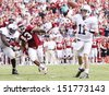 PHILADELPHIA, PA. - SEPTEMBER 17: Penn State quarterback Matt McGloin avoids the rush against Temple on September 17, 2011 at Lincoln Financial Field in Philadelphia, PA.  - stock photo