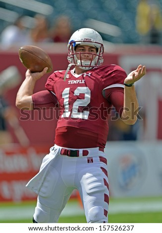 PHILADELPHIA - SEPTEMBER 14: Temple Owls quarterback Connor Reilly (12) throws a pass prior to the football game against Fordham September 14, 2013 in Philadelphia, Pennsylvania.