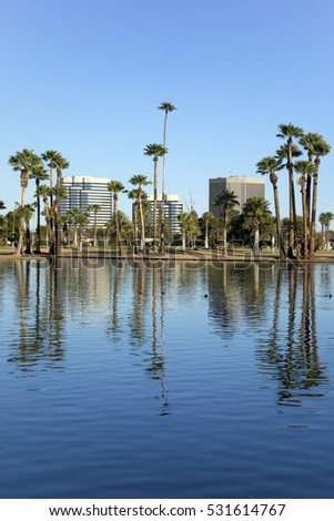 Phoenix downtown as seen across the lake in Encanto Park, Arizona; Copyspace