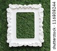 photo frame isolated on green grass - stock photo