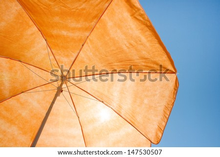 Photo of a beach umbrella on the blue sky,Beach umbrella