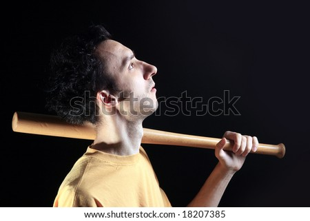 photo of a man with baseball stick