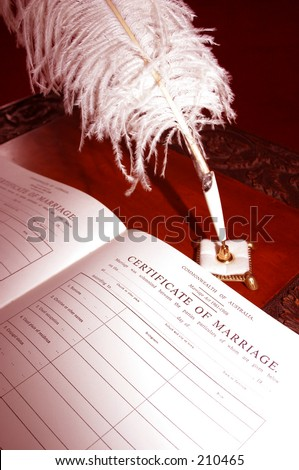 Photo of a wedding registry and feather pen.