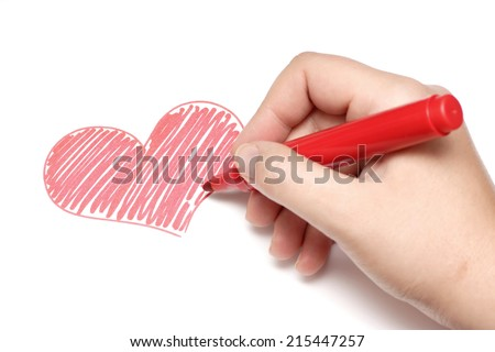 Photo of a woman's hand drawing a picture of a heart with a red marker