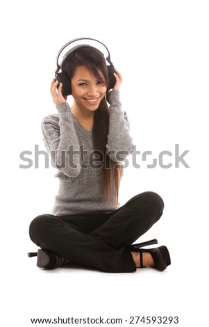 Photo of asian woman listening music with headphones over white isolated background