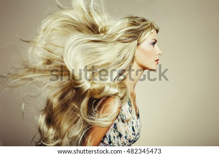 stock photo photo of beautiful woman with magnificent hair blonde girl with long and shiny wavy hair 482345473 Wife in romanian   the day of all bulgarian saints