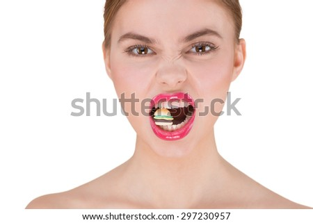 Photo of beautiful young woman with glossy pink lips. Woman biting small figure of cheeseburger