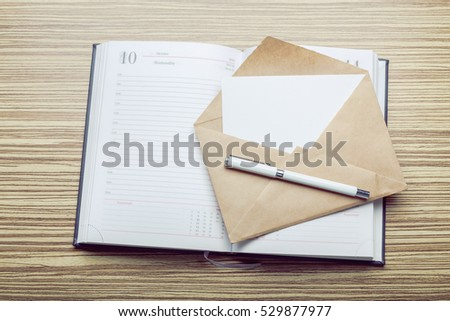Photo of blank envelope on a  wooden background