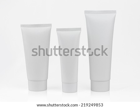 photo of blank product packages isolated on white