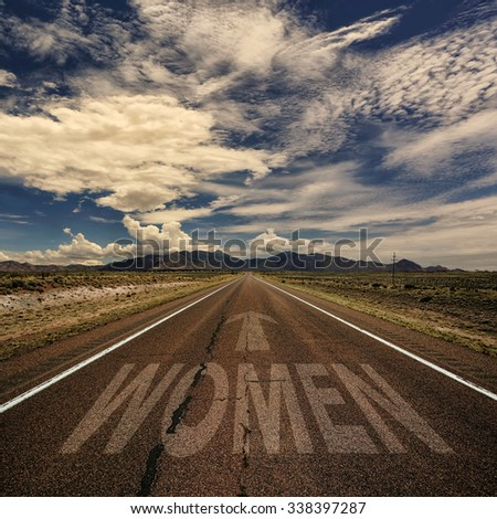 Photo of desert road with the word women and arrow