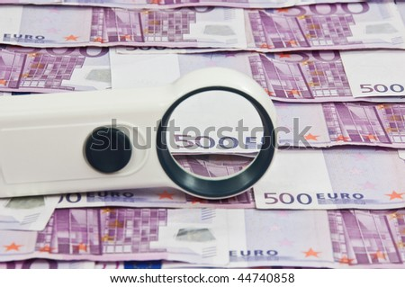photo of 500 euro bills and magnifying glass vista