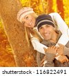 Photo of happy couple hugging each other in autumn park - stock photo