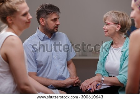 Photo of patients talking with psychologist about their problems