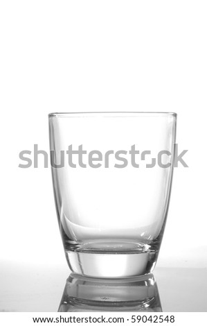 photo of pouring water and glass on white background